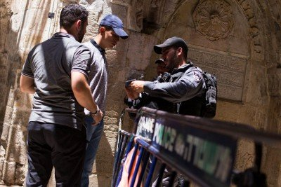 Israeli Police check documents at the entrance to Temple Mount